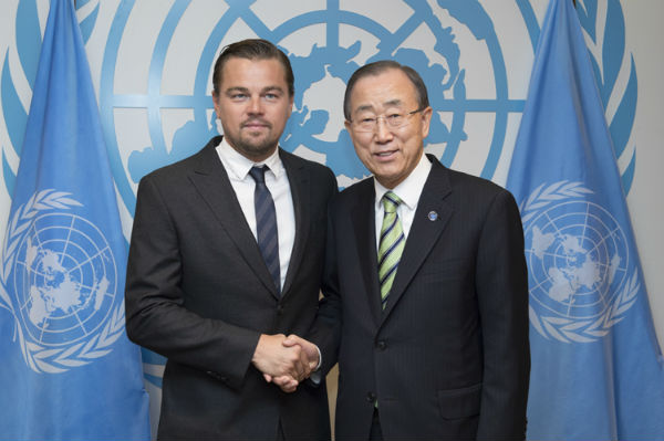 Actor Leonardo DiCaprio, the UN Messenger of Peace, who addressed the opening of the signing ceremony for the Paris climate change agreement, seen with Seceretary General Ban Ki-moon Friday, April 22, 20016. (Credit: UN/IANS)