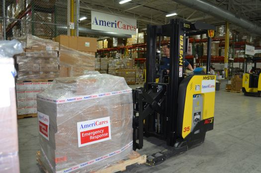 A shipment of medicine headed to Nepal is packed in AmeriCares Stamford, Conn., distribution center.