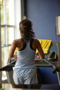 Young woman running on the treadmill, fitness series (Photo: Harvard)
