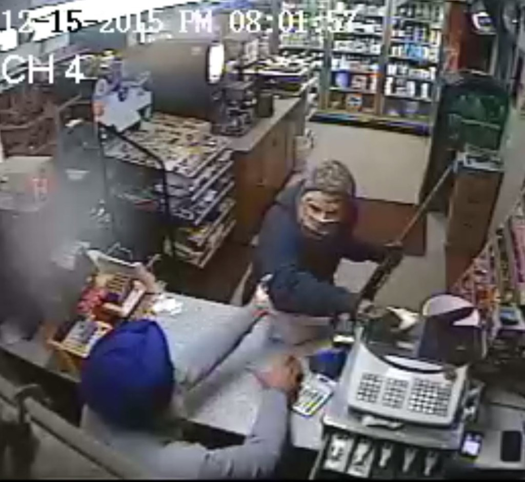 Caption for amriksingh2: Amrik Singh is seen confronting a masked gunman Tuesday (Dec. 15, 2015) at his petrol station in Staatsburg, about 160 km from New York City, in a still from a surveillance video. Singh threw a slipper at the gunman trying to rob the store ,momentarily distracting him, and charged at him. The gunman fled after firing a shot that missed Singh. (Credit: Courtesy of New York State Police)
