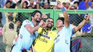 Seven goals were scored by either teams in the last 13 minutes to set up a thrilling shootout. In the shootout goalkeeper PR Sreejesh (C) made three crucial saves for the home team. (Photo courtesy: Indian Express.)