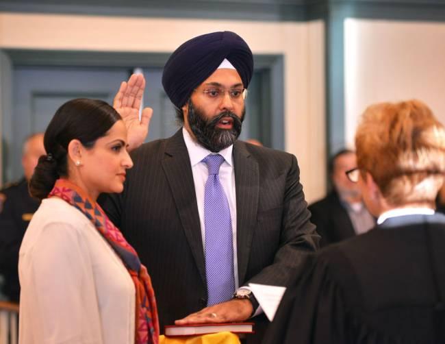 Gurbir Grewal is sworn in as Acting Bergen County Prosecutor by Judge Bonnie J. Mizdol as his wife Amrit looks on Monday, Jan. 4, 2016. (Photo courtesy: Mitsu Yasukawa/Staff Photographer; North Jersey .com)