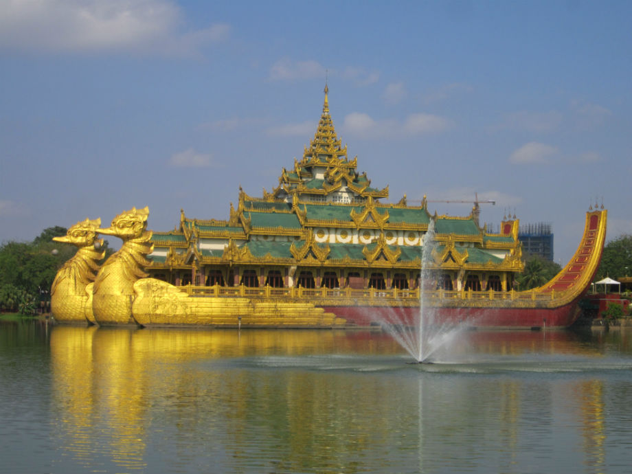 The Karaweik Palace restaurant, built to look like a royal golden teak barge, seems floating on the Kandawgyi Lake in the heart of Yangon in Myanmar.