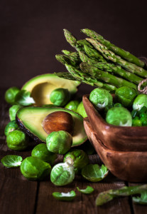 Assortment of fresh green vegetables on wooden table