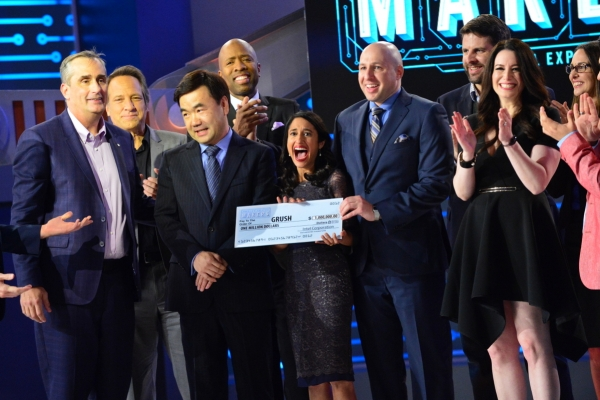 Interactive digital toothbrush created by a team of parent entrepreneurs wins America's Greatest Makers. Front row (from left): Brian Krzanich, Intel CEO and show judge; Yongjing Wang, Team Grush; Dr.Anubha Sacheti, Team Grush; Ethan Schur, Team Grush; Carol Roth, show judge. Back row (from left): Mike Rowe, guest judge; Kenny Smith, guest judge; Jonathan Schaffer, Team ASEAH; Aleda Schaffer Team ASEAH. (Credit: Tommy Baynard/Intel Corporation)