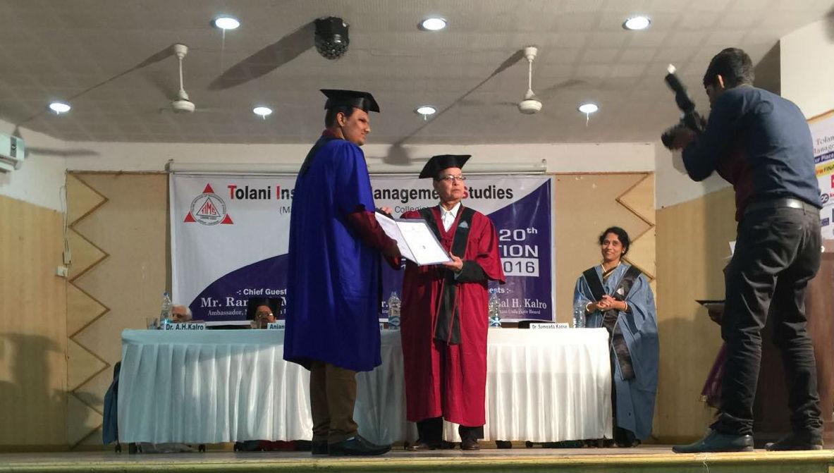 Ramesh Motwane awarding degrees to graduating students.