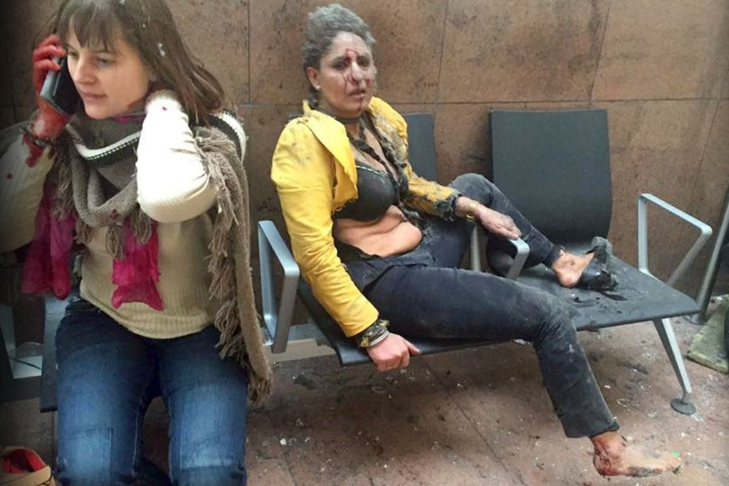 FILE PHOTO: State of shock ... flight attendant Nidhi Chaphekar (right) slumps on a bench following the bomb blast at Brussels aiport  (Photo courtesy: Associated Press)