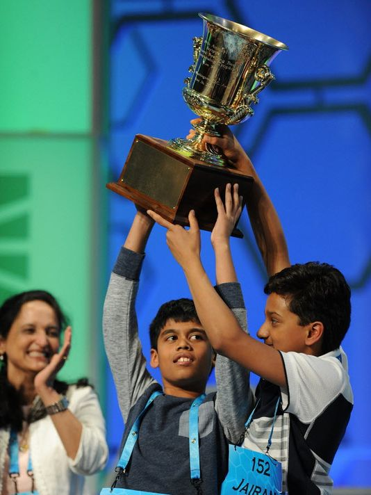 Jairam Hathwar, 13, of Painted Post, N.Y., left, and Nihar Janga, 11, of Austin, Texas, celebrate as co-champions during the 2016 Scripps National Spelling Bee, in National Harbor, Md. (Photo courtesy: Christopher Powers, USA TODAY