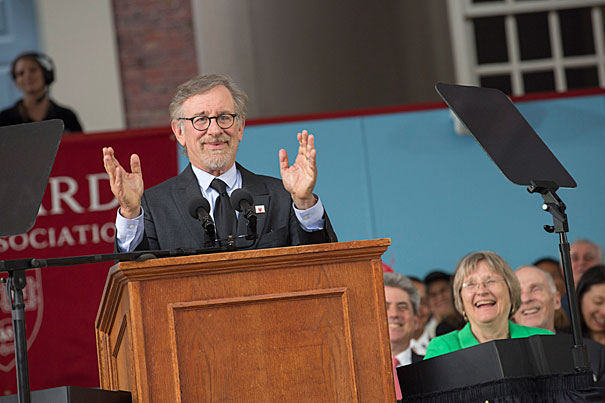 Commencement speaker Steven Spielberg gives his oration during The Annual Meeting of the Harvard Alumni Association (HAA) in the Tercentenary Theatre. Harvard President Drew Faust looks on. Kris Snibbe/Harvard Staff Photographer