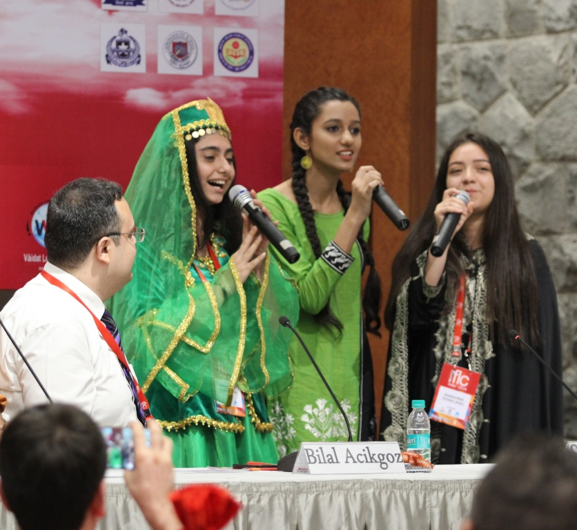 Students from other countries with Indian student singing Hindi song at ILFC 2016 press conference