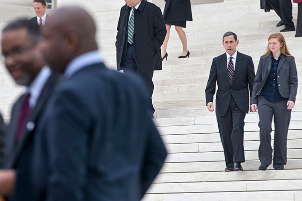 Abigail Fisher, who challenged the use of race in college admissions, right, walks with lawyer Edward Blum following oral arguments in the Supreme Court in Washington, Wednesday, Dec. 9, 2015, in a case that could cut back on or even eliminate affirmative action in higher education. At far left is Gregory J. Vincent, left, the University of Texas vice president for diversity, and other members of the UT group. (AP Photo/J. Scott Applewhite) Courtesy: Harvard Gazette.)