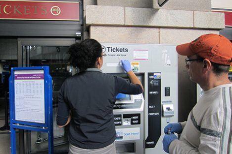 Researchers Regina Joice and Jose Vallarino swab subway ticket machines