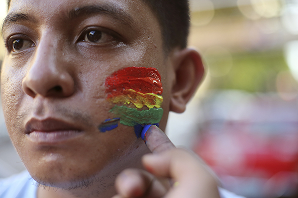 A Filipino youth activist has his face painted in rainbow colors as they gather in solidarity with victims of the mass shooting at the Pulse nightclub in Orlando, Florida during a gathering in Manila, Philippines on Tuesday June 14, 2016. The group calls for justice for the victims of the mass shooting. (AP Photo/Aaron Favila) Courtesy: Harvard Gazette.)