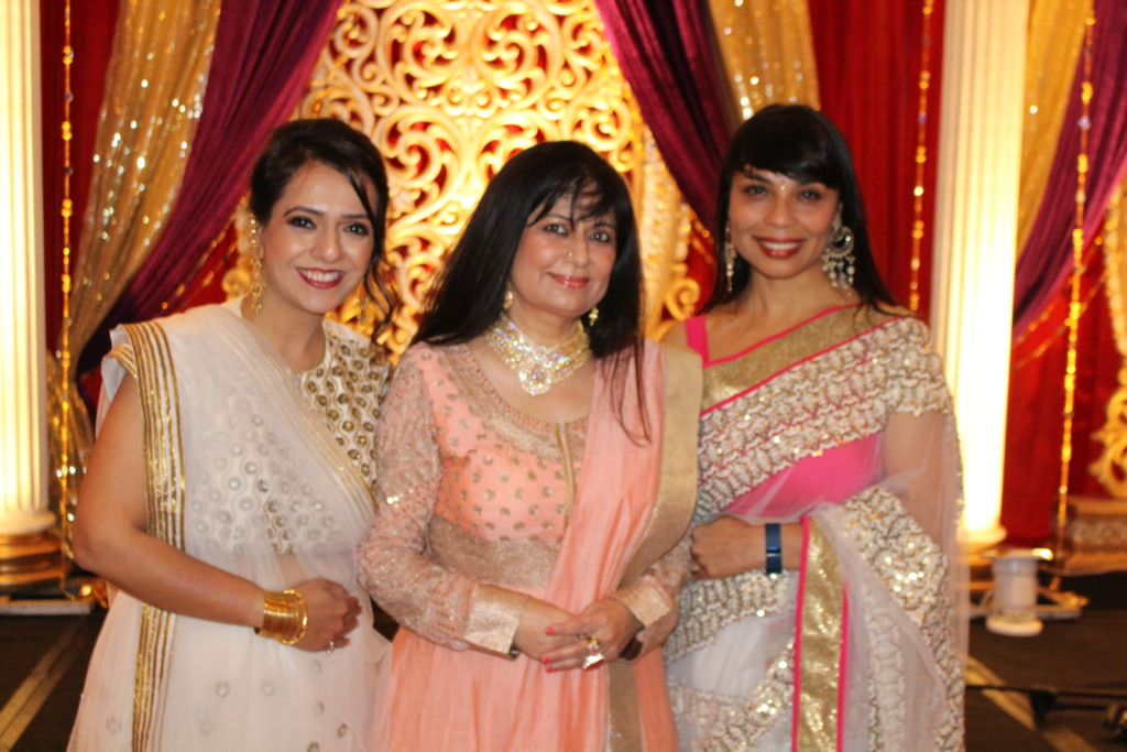 Hostess Manju Sheth (center) and Masters of Ceremonies Jharna Madan (left) and Mandy Pant (Right): Photo Rasik Mehta)