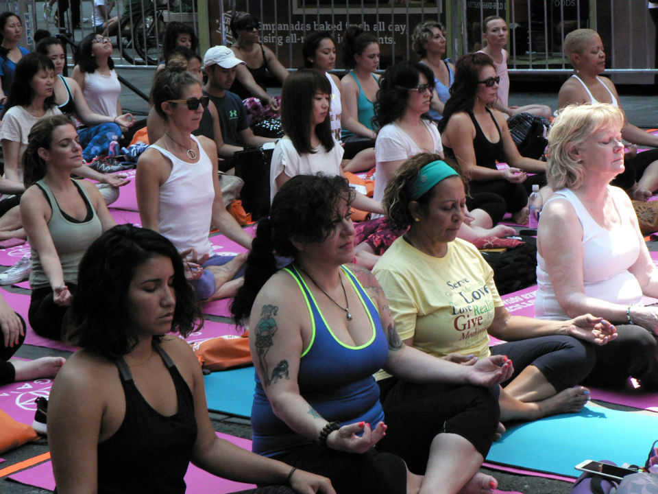 """Reflecting the multinational character of Times Square, known as the """"Crossroads of the World,"""" people of many ethnicities participated in the International Yoga Day celebrations on Monday, June 20. (Credit: IANS)"""