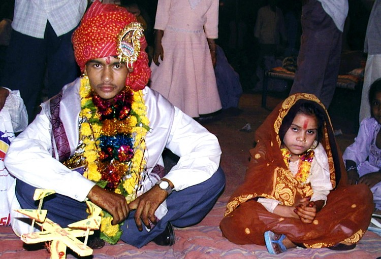 A 16 year old boy being married to a much younger girl (Photo courtesy:  Millennium India Education Foundation)