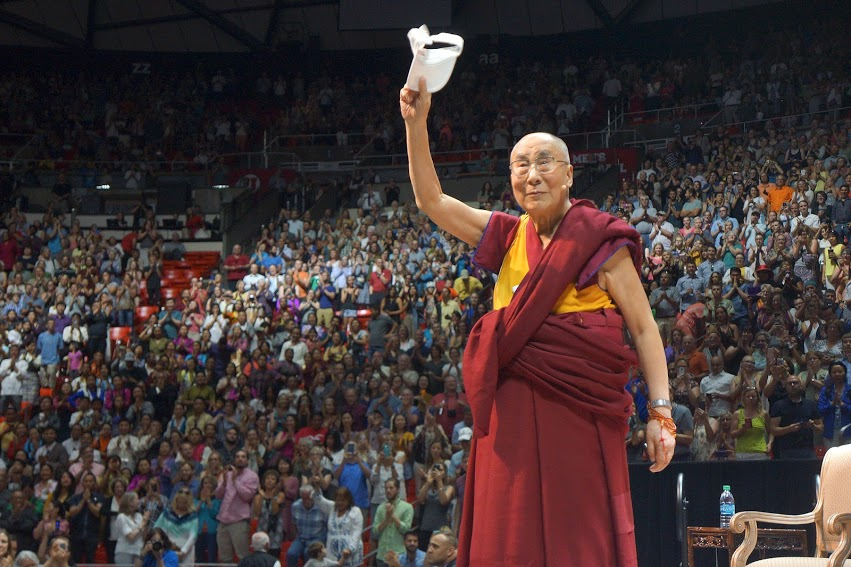 "His Holiness the Dalai Lama waving to the audience at the end of his talk on ""Compassion and Universal Responsibility"" at the University of Utah's Huntsman Center in Salt Lake City, Utah on June 21, 2016. (Photo/Jeremy Russell/OHHDL)"