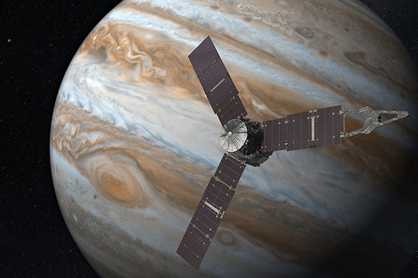 Juno Artist's Rendering Launching from Earth in 2011, the Juno spacecraft will arrive at Jupiter in 2016 to study the giant planet from an elliptical, polar orbit. Juno will repeatedly dive between the planet and its intense belts of charged particle radiation, coming only 5,000 kilometers (about 3,000 miles) from the cloud tops at closest approach. Credit: Juno Artist's Rendering/NASA