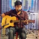 drift-2-Maitrya Das-sing Bengali song on his Guitar