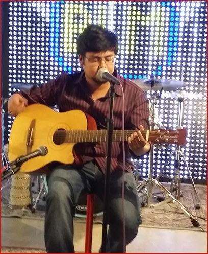 Maitrya Das sings Bengali song on his Guitar
