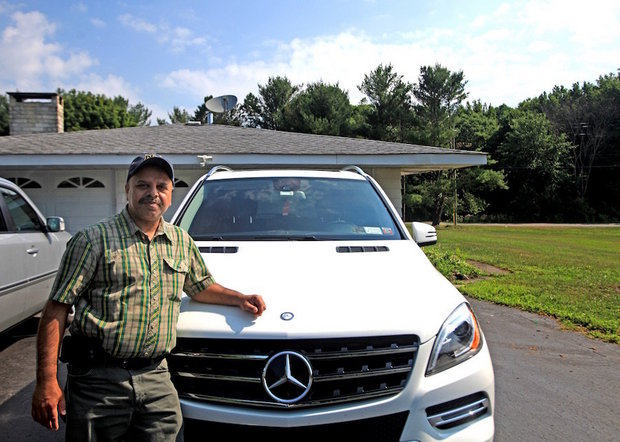 Surjeet Bassi next to the Mercedes he had hoped to replace with a new one from Prestige Motors in Paramus. (Photo courtesy of Elaine A. Ruxton | Times Herald-Record)  and NJ.com.