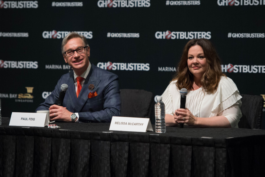 """Paul Feig and Melissa McCarthy speak at the """"Ghostbusters"""" press conference at the ArtScience Museum at Marina Bay Sands on June 13, 2016 in Singapore."""