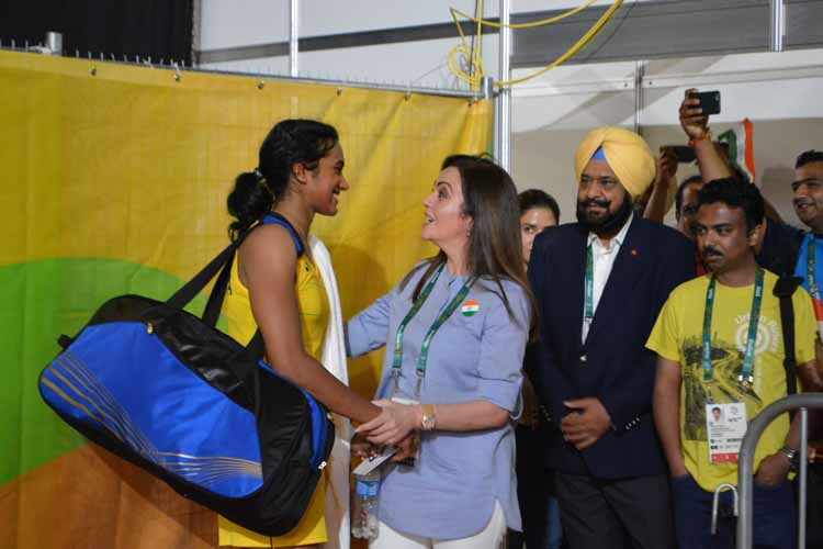 India\'s P.V. Sindhu, who thumped Nozomi Okuhara of Japan to enter the final of the women\'s singles event of badminton competitions at the Rio 2016 Olympic Games with IOC member Nita Ambani in Rio de Janeiro, Brazil on Aug 18, 2016. (Photo: IANS)