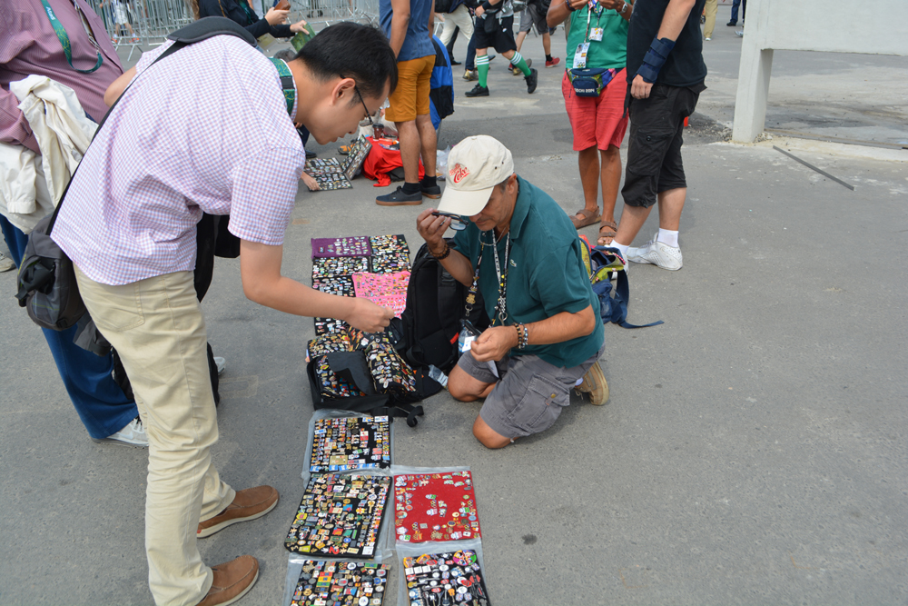Pin collectors with their wares outside the Rio 2016. Olympic stadia add colour and informal social exchange at games, Rio de Janeiro.