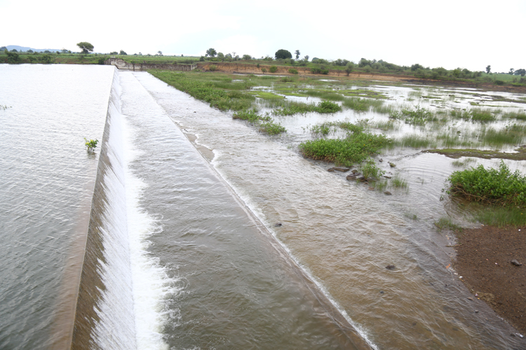 Surplus water overflowing from a tank