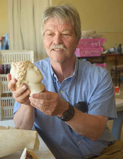 North Carolina State University Professor of History Tom Parker examines a statue of Aphrodite, discovered during a 2016 excavation in Petra, Jordan. Photo: Tom Parker.