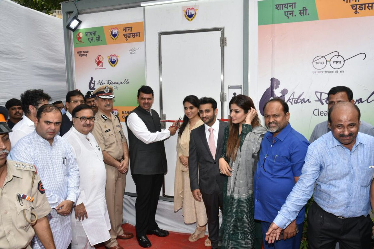 Chief Minister Devendra Fadnavis, Police Commissioner Datta Padsalgikar, Cyrus Poonawalla Group CEO Adar C. Poonawalla, BJP national spokesperson Shaina N.C., Bollywood actress Raveena Tandon and other dignitaries at the launch of eco-friendly toilets in Mumbai.