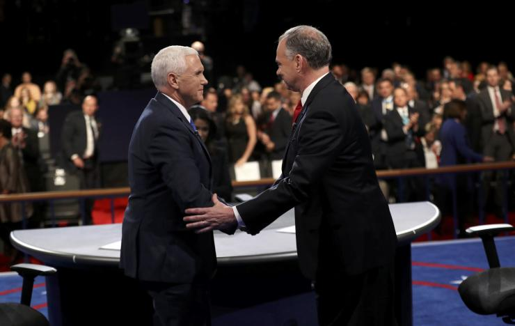 Democratic U.S. vice presidential nominee Senator Tim Kaine (R) and Republican U.S. vice presidential nominee Governor Mike Pence shake hands at the end of their vice presidential debate at Longwood University in Farmville, Virginia, U.S., October 4, 2016. (Photo courtesy: REUTERS/Joe Raedle/Pool