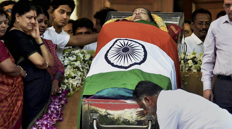 Tamil Nadu Chief Minister O Pannerselvam paying his last respects to his leader and former Chief Minister J Jayalalithaa at Rajaji Hall in Chennai on Tuesday (PTI Photo by R Senthil Kumar) Courtesy: Indian Express.)