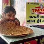 Tapasya Paratha-person eating