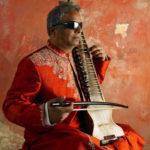 Baluji Shrivastav-red-vertical